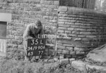 SD990635L, Man marking Ordnance Survey minor control revision point with an arrow in 1950s
