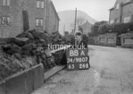 SD980788A, Man marking Ordnance Survey minor control revision point with an arrow in 1950s