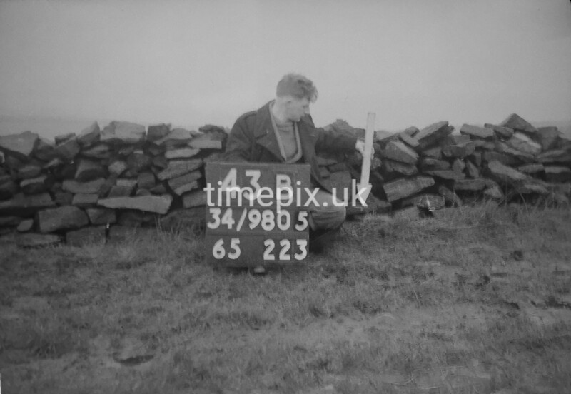 SD980543B, Man marking Ordnance Survey minor control revision point with an arrow in 1950s