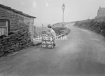 SD980900B, Man marking Ordnance Survey minor control revision point with an arrow in 1950s