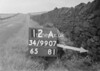 SD990712A, Man marking Ordnance Survey minor control revision point with an arrow in 1950s
