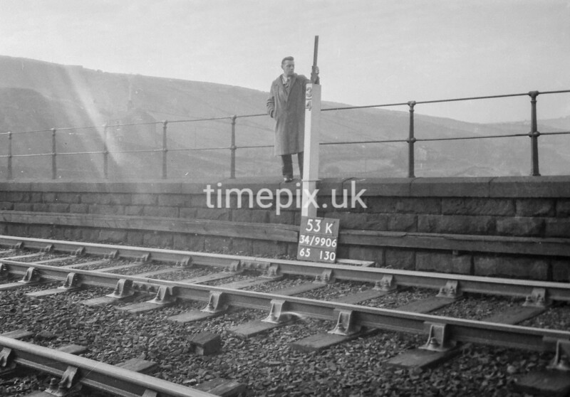 SD990653K2, Man marking Ordnance Survey minor control revision point with an arrow in 1950s