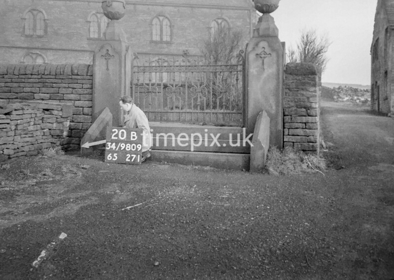 SD980920B, Man marking Ordnance Survey minor control revision point with an arrow in 1950s
