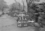 SD990535A2, Man marking Ordnance Survey minor control revision point with an arrow in 1950s