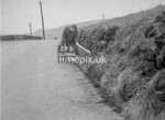 SD980629B, Man marking Ordnance Survey minor control revision point with an arrow in 1950s