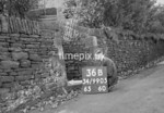 SD990536B, Man marking Ordnance Survey minor control revision point with an arrow in 1950s