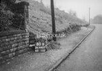 SD990780B2, Man marking Ordnance Survey minor control revision point with an arrow in 1950s