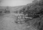 SD980745B, Man marking Ordnance Survey minor control revision point with an arrow in 1950s