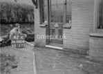 SD980842K, Man marking Ordnance Survey minor control revision point with an arrow in 1950s