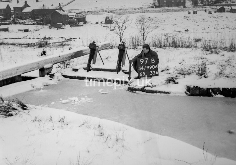 SD990697B3, Man marking Ordnance Survey minor control revision point with an arrow in 1950s
