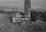 SD990513A, Man marking Ordnance Survey minor control revision point with an arrow in 1950s