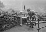 SD990635A, Man marking Ordnance Survey minor control revision point with an arrow in 1950s