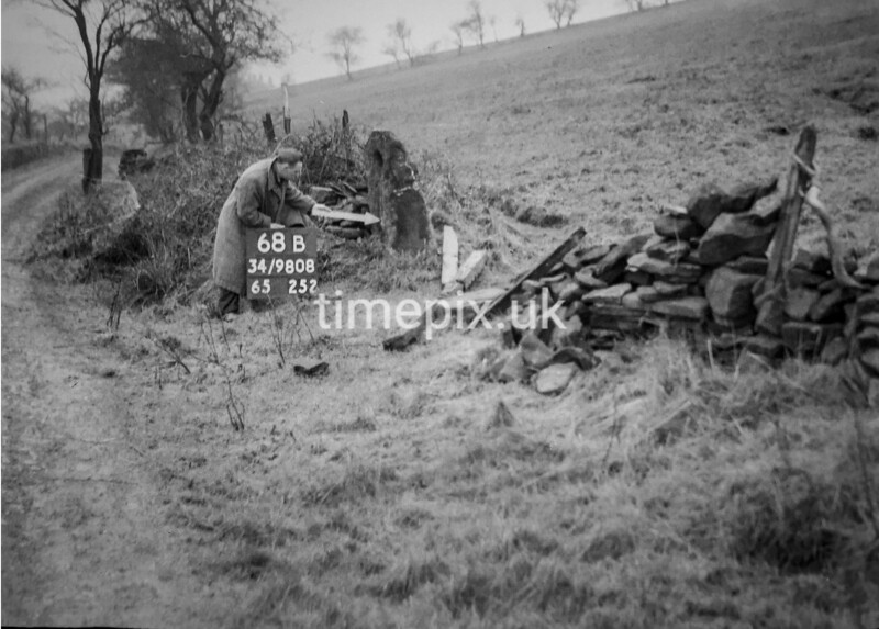 SD980868B, Man marking Ordnance Survey minor control revision point with an arrow in 1950s