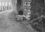 SD990642B, Man marking Ordnance Survey minor control revision point with an arrow in 1950s