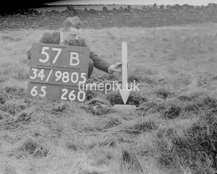 SD980557B1, Man marking Ordnance Survey minor control revision point with an arrow in 1950s