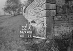 SD990811B1, Man marking Ordnance Survey minor control revision point with an arrow in 1950s