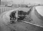SD990652A2, Man marking Ordnance Survey minor control revision point with an arrow in 1950s