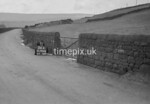 SD990836A, Man marking Ordnance Survey minor control revision point with an arrow in 1950s