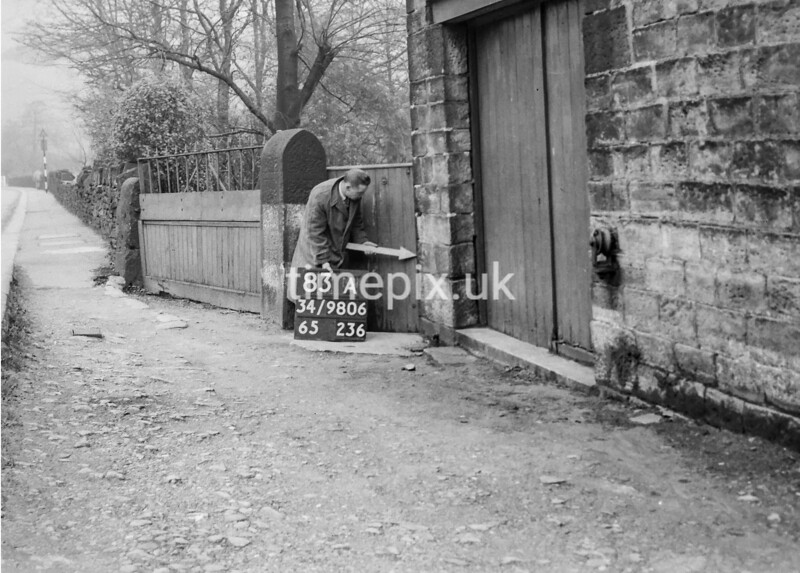 SD980683A, Man marking Ordnance Survey minor control revision point with an arrow in 1950s
