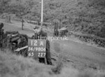 SD980612A, Man marking Ordnance Survey minor control revision point with an arrow in 1950s