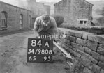 SD980884A1, Man marking Ordnance Survey minor control revision point with an arrow in 1950s
