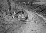 SD980867B, Man marking Ordnance Survey minor control revision point with an arrow in 1950s