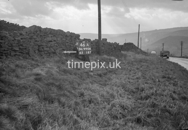 SD990846A1, Man marking Ordnance Survey minor control revision point with an arrow in 1950s