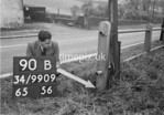 SD990990B, Man marking Ordnance Survey minor control revision point with an arrow in 1950s