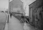 SD980748B, Man marking Ordnance Survey minor control revision point with an arrow in 1950s