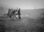 SD980862A, Man marking Ordnance Survey minor control revision point with an arrow in 1950s