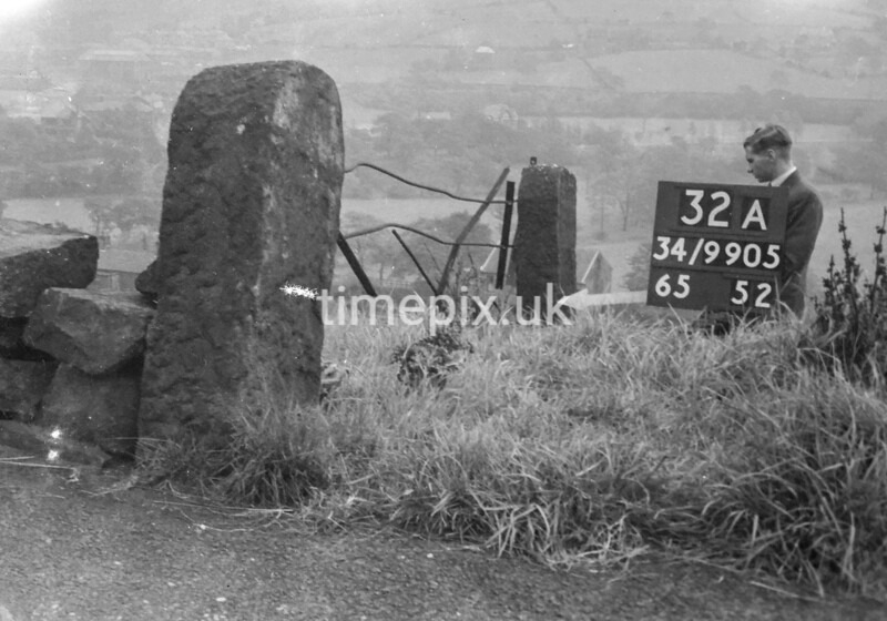 SD990532A, Man marking Ordnance Survey minor control revision point with an arrow in 1950s