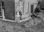 SD980608B, Man marking Ordnance Survey minor control revision point with an arrow in 1950s