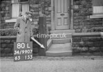 SD990780L2, Man marking Ordnance Survey minor control revision point with an arrow in 1950s