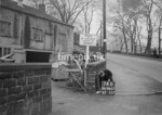 SD980774B, Man marking Ordnance Survey minor control revision point with an arrow in 1950s