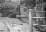 SD990666S, Man marking Ordnance Survey minor control revision point with an arrow in 1950s