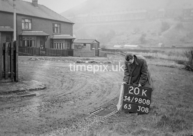 SD980820K, Man marking Ordnance Survey minor control revision point with an arrow in 1950s