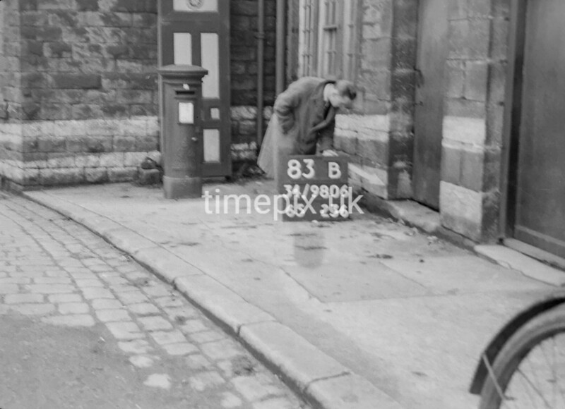 SD980683B, Man marking Ordnance Survey minor control revision point with an arrow in 1950s