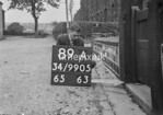 SD990589A, Man marking Ordnance Survey minor control revision point with an arrow in 1950s