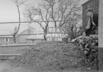 SD990795A1, Man marking Ordnance Survey minor control revision point with an arrow in 1950s
