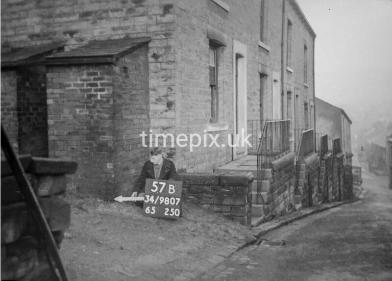 SD980757B, Man marking Ordnance Survey minor control revision point with an arrow in 1950s