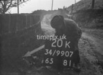 SD990720K, Man marking Ordnance Survey minor control revision point with an arrow in 1950s