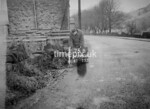 SD980675B, Man marking Ordnance Survey minor control revision point with an arrow in 1950s