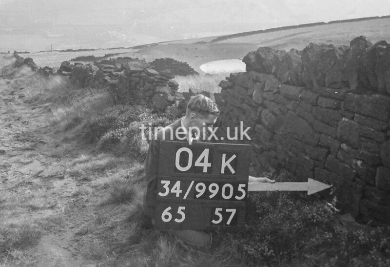 SD990504K2, Man marking Ordnance Survey minor control revision point with an arrow in 1950s