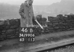 SD990646B1, Man marking Ordnance Survey minor control revision point with an arrow in 1950s