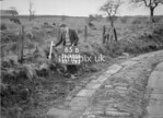SD980865B, Man marking Ordnance Survey minor control revision point with an arrow in 1950s