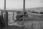 SD990695B1, Man marking Ordnance Survey minor control revision point with an arrow in 1950s