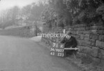 SD980771K, Man marking Ordnance Survey minor control revision point with an arrow in 1950s