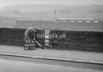 SD990793B1, Man marking Ordnance Survey minor control revision point with an arrow in 1950s