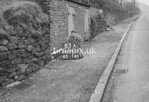 SD990783A2, Man marking Ordnance Survey minor control revision point with an arrow in 1950s