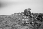 SD980557A, Man marking Ordnance Survey minor control revision point with an arrow in 1950s